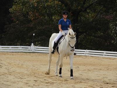 Megan Pustarfi riding Astaire. Megan won Training Level Test 2 with a score of 70.385%