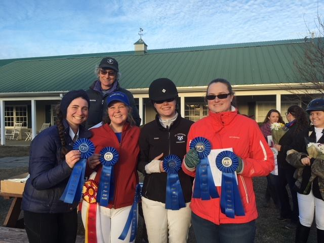 Four St. Andrews riders and their coach with blue and championship ribbons