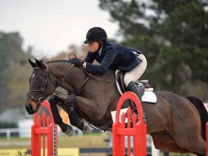 Ashley Duda jumping Petey